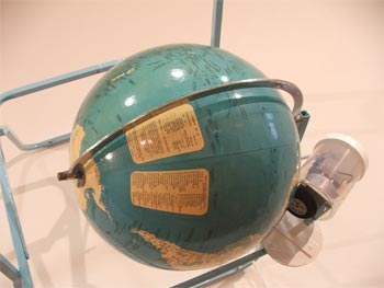 Paul Cullen, Geographer (2), 1995, metal chair, world globe, motor and electric cord. 700 x 800 x 600 mm. Image courtesy of the artist and Jane Sanders.