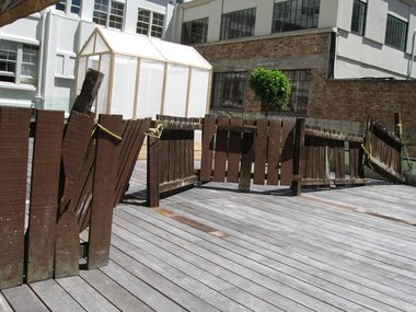 Greenhouse and borrowed fence: works by Ross Forbes and Anthony Cribb on the the terraced rooftop next to CNZ's Auckland offices.