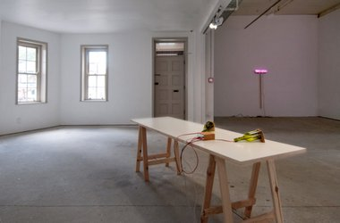 Force Things installed at Gallery Three. On the far wall is Fibre Optic Broom, 2010, by Eddie Clemens. On the table is Soap Box by Michael Grobelny