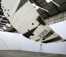 Lauren Brincat, Southeasterlies to the Doldrums, 2012 Nautical sail, adhesive nautical fabric, cassette tape 1400 x 600 x 15 cm