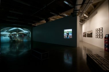 Left to right. Rebecca Ann Hobbs, Mangere Mall, 2011, single channel digital video; Louise Afoa, Reload, 2011, single channel video; Mark Adams, Hinemihi, Clandon Park, Surrey..., 2000, C types, and Hinemihi, Te Wairoa..; Ans Westra, Washday at the Pa.