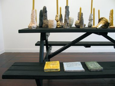 Detail of Richard Orjis installation, by quiet volcanoes. on the seat are painted ceramic 'books' by Tessa Laird.
