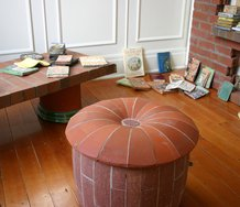 Reading Room (2012) at Objectspace Window Gallery: Tessa Laird, Clay Tablets, ceramic (earthenware and paperclay), ceramic paint, glaze; Peter Lange, Brick Bookcase, Table, Pouffe and Armchair, 2012, brick, timber, drainage tile. Courtesy of the artists