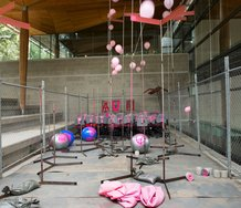 et al., many to many, 2013 (installation detail), roller chairs, signage, metal tubing, sandbags, helium balloons, swiss balls, particle board, original installation in collaboration with Sean Curham one-to-many and many-to-one Khartoum Place 2010.