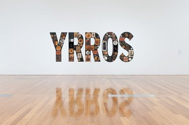 Tony Albert, Girramay people, QLD, Sorry, found kitsch objects applied to vinyl letters, 99 objects, 200 x 510 x 10 cm installed. The James C. Sourris,AM, Collection, Purchaed 2008 with funds from James C Sourris through the QAG Foundation