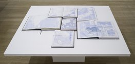 Tania Kovats, Only Blue, 2013, table, open atlases, acrylic. Courtesy of the artist. Photograph: Ruth Clark