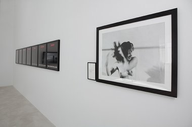 Installation of RE:VISION at Trish Clark Gallery. On the left, Alfredo Jaar's Tonight No Poetry Will Serve; on the right, Marina Abramovic's Art Must Be Beautiful, Artist Must Be Beautiful, 1975; publ. 1994, black and white photograph with text panel