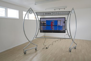 "Eddie Clemens: 'Wes Craven Marina', 2014, Hot-dip galvanized mild metal, printed vinyl, opal acrylic, casters, Samsung 51"" F4500 USB movie HD plasma TV, SanDisk Ultra 3.0 flash drive, IEC right angle (Jug lead), 2890x2090x89mm.Photo credit: Sam Hartnett"