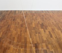 Philippa Nielsen, Drawing Machine, detail, disco motor, square sticks, sellotape, yellow thread, yellow outdoor masking tape