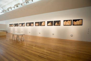 Peter Roche, Museum Piece, 1993, Framing the Museum in Ngā Toi │ Arts Te Papa, 22 August 2014 - 01 March 2015, photographs, clocks, wall text. Purchased 1993 (1993-0040-2). Image Courtesy of Te Papa.