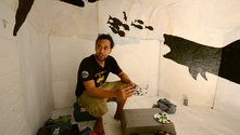 Seleka Club member Tevita Mamani at a painting workshop inside Vataulua's 'secret room'. Photograph by Adam Douglass.