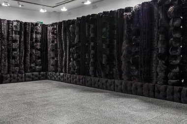 Kathy Temin, The Memorial Project: Black Wall, 2015  5.5 x 12.5 m x 2.95 m. As installed at the Gus Fisher Gallery. Image courtesy of the artist. Photo: Sam Hartnett.