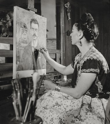Frida painting the portrait of her father by Gisèle Freund, 1951 ©Frida Kahlo Museum