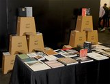 The Art Books NZ stall run by Kelvin Soh and Anita Totha.