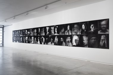 Trent Clarke's The Camera as God: Street Portrait Series, as installed at Two Rooms. This is the lefthand wall. Photo: Sam Hartnett.