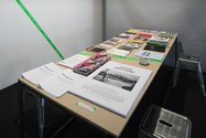 Exhibition design by Andrew Kennedy. Table with contextual reading matter. Photo: Sam Hartnett