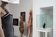 On the far right, Beatrice Carlson,  Costume in which to engage in the murder/suicide of self-criticism: platform shoe in glass cabinet with chef knife as heel. photo: Sam Hartnett