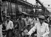 Tom Hutchins, Steel workers at Anshan knock off, afternoon. Copyright Tom Hutchins Images Ltd