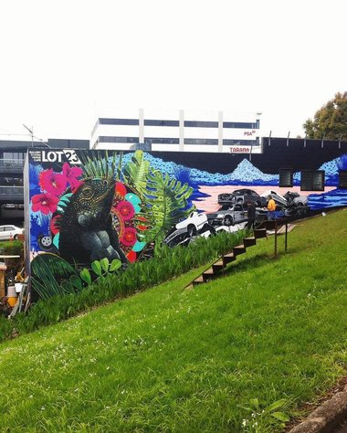 Aroha Novak and Guy Howard-Smith, outside mural at Lot23. Photo: Arielle Walker