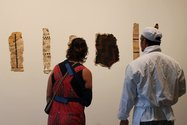 Visitors to the gallery examine some of the paintings produced by Hindin's wananga aute.