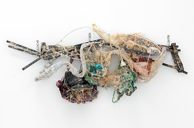 Alex Vivian, Entry level sculpture (things), 2015, metal fencing, iron, wire, handbag, clothing cut-offs, rust, flannelette, glue, paper, plastic plane, towel, synthetic fur, adhesive, 500 x 1200 x 250 approx. mm