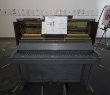 et al. & Samuel Holloway: Upright Piano, 2013, painted and modified piano, annotated score; et al., DE NIEUWE STEM 1-3, 2006, frame, metal box, light fittings, acrylic & oil stick on paper, mp3 paper, headphones, Chartwell Collection, Auckland Art Gallery