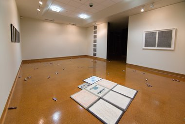 Installation of Campbell Patterson's 'toot floor' exhibition in the Hocken Collections Gallery