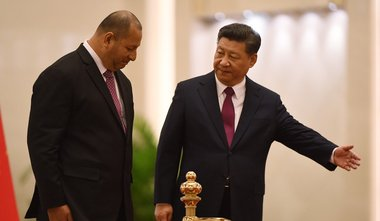 Tonga's King Tupou VI accepts the lead of Chinese dictator Xi Jinping during a visit to Beijing, March 2018. Photograph from the 'South China Morning Post.'