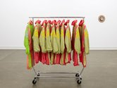 Ani O'Neill, SQUAD SUITS (2004 - ), collection of found shell-tracksuits, rack, hangers. Photo: Sam Hartnett