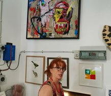 Annie Wilson with a painting by Ercan Cairns, Miranda Farm Gallery.